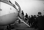 Irish Rugby Team Departs For France..1966..29.01.1966..01.29.1966..29th January 1966..The Irish rugby team departed Dublin Airport today for Saturday's meeting with France in Paris...Image shows the Irish Rugby team and officials boarding the aircraft as they set off for their opening five nations encounter with France in Paris.