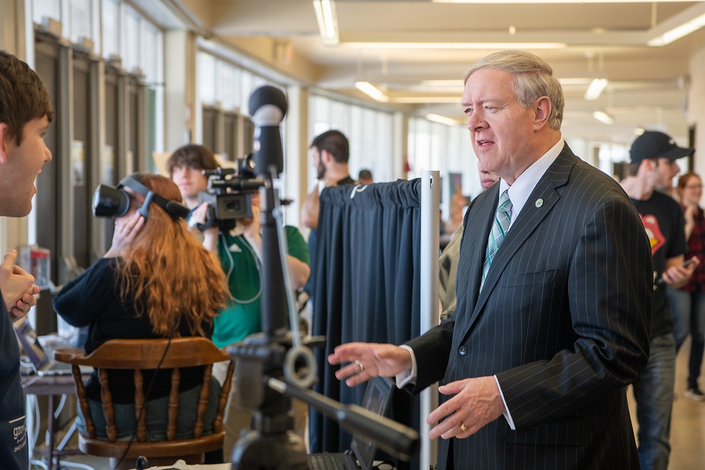 President Nellis talks with students at the student Expo. Photo by Ben Siegel