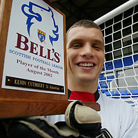 Bells player of Month...13.9.2002.<br />St Johnstone FC goalkeeper Kevin Cuthbert with his Bells Player of the Month award presented to him on Friday morning at McDiarmid Park, Perth.<br />Please see Bells Press Release for more info.<br /><br />Picture by Graeme Hart.<br />Copyright Perthshire Picture Agency<br />Tel: 01738 623350  Mobile: 07990 594431