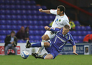 Stockport - Saturday October 31st 2009: Peter Thompson of Stockport County in action against Darel Russell of Norwich City during the Coca Cola League One match at Edgeley Park, Stockport. (Pic by Michael SedgwickFocus Images)