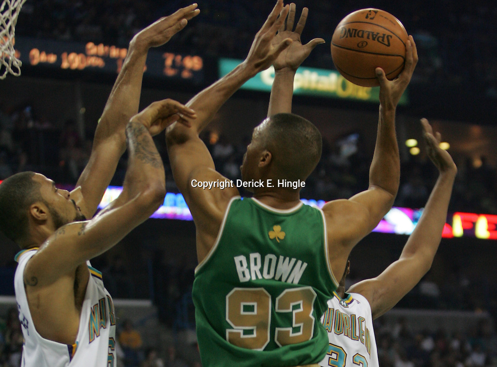 P.J. Brown #93 of the Boston Celtics shoots over New Orleans Hornets center Tyson Chandler #6  in the second quarter of their NBA game on March 22, 2008 at the New Orleans Arena in New Orleans, Louisiana. The New Orleans Hornets defeated the Boston Celtics 113-106.