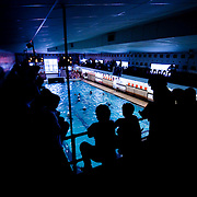 September 29, 2010 - Bronx, NY : The Horace Mann water polo team were overcome by a dominant St. Benedict's squad in their Sept. 29 matchup. People watch the game from the balcony above the pool.