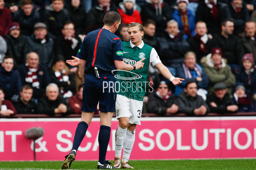 Craig Thompson talking to Hibernian FC Forward Jason Cummings during the Scottish Cup 5th round match between Heart of Midlothian and Hibernian at Tynecastle Stadium, Gorgie, Scotland on 7 February 2016. Photo by Craig McAllister.