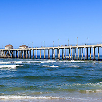 Huntington Beach Pier panoramic photo. Panorama photo ratio is 1:3. Huntington Beach Pier is a registered historic place.  Huntington Beach is also known as Surf City USA and is a seaside beach city along the Pacific Ocean in Southern California.