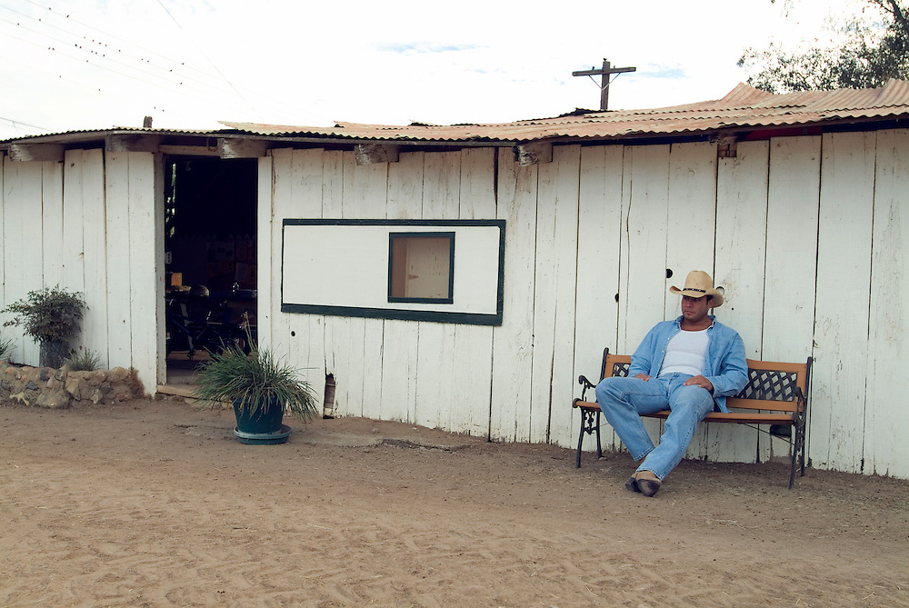 Lifestyle image of rancher resting outside in San Diego, CA.