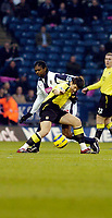 Photo: Leigh Quinnell.<br /> West Bromwich Albion v Manchester City. The Barclays Premiership. 10/12/2005. West Broms Nwankwo Kanu battles with man Citys Joey Barton.