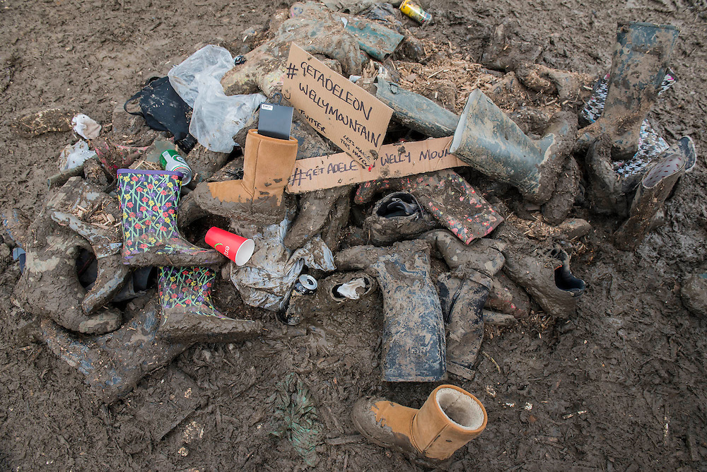 Mud, the wellingtons graveyard - The 2016 Glastonbury Festival, Worthy Farm, Glastonbury.
