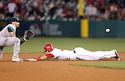 ANAHEIM, CA - APRIL 15:  Mike Trout #27 of the Los Angeles Angels of Anaheim safely steals second base during the game against the Oakland Athletics at Angel Stadium on Tuesday, April 15, 2014 in Anaheim, California. The Athletics won the game 10-9 in eleven innings. (Photo by Paul Spinelli/MLB Photos via Getty Images) *** Local Caption *** Mike Trout