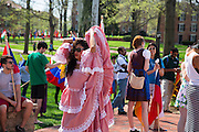 Jessica Gonzalea, dances around college green in her Spanish flamenco dress before the start of the 2015 International Street Fair Parade.