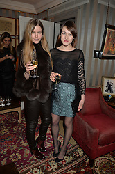 Left to right, KATIE READMAN and ELLA CATLIFF at a ladies lunch hosted by Katie Readman for sisters Lucia & Rosie Ruck Keene founders of a new fashion label - Troy, held at 5 Hertford Street, London on 27th January 2015.