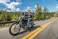 Riding a motorcycle on Colorado highway 82 near Aspen, Colorado.