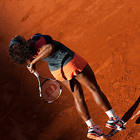 30 May 2009: Serena Williams of USA serves during the the Women's Third Round match on day seven of the French Open at Roland Garros in Paris, France.