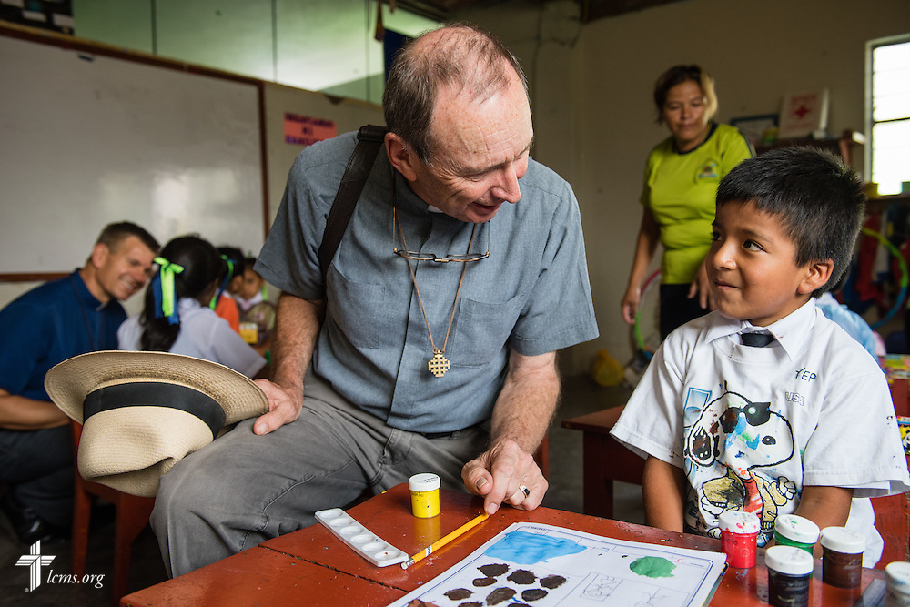 The Rev. Herb Burch, LCMS career missionary to Peru, visits with students at the Noe (Spanish for Noah) school, one of many places affected by recent landslides near Lima, Peru, on Tuesday, April 7, 2015.  To the left rear of Burch is the Rev. Mark Eisold, fellow career missionary to Peru. LCMS Communications/Erik M. Lunsford