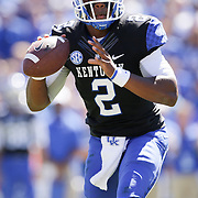 UK quarterback Jalen Whitlow looks for a receiver in the third quarter as the University of Kentucky plays the University of Louisville at Commonwealth Stadium in Lexington, Ky. Saturday Sept. 14, 2013. Louisville beat Kentucky 27-13. Photo by David Stephenson