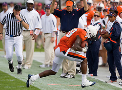 Virginia wide receiver Kevin Ogletree (20) drags a toe to make a sideline reception in front of head coach Al Groh.  The Virginia Cavaliers defeated the #3 ranked (NCAA Division 1 Football Championship Subdivision) Richmond Spiders 16-0 in a NCAA football game held at Scott Stadium on the Grounds of the University of Virginia in Charlottesville, VA on September 6, 2008.
