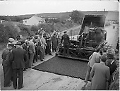 1952 Roadstone Ltd. Hill of Allen quarry, blasting and demonstration of road-laying by machine