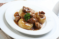 Silesian dumplings on white plate