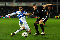 Football - 2018 / 2019 Emirates FA Cup - Fourth Round, Replay: Queens Park Rangers vs. Portsmouth<br /> <br /> Darnell Furlong of QPR has his shirt pulled by Lee Brown of Portsmouth, at Loftus Road.<br /> <br /> COLORSPORT/ANDREW COWIE