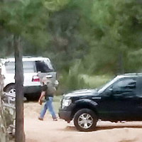 A Cibola County Sheriff's officer approaches a residence in Bluewater Acres where Matthew Joe, a suspect in an Albuquerque homicide, was arrested Tuesday.