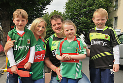 Marian and Ray McNamara with their kids on their way to the All Ireland Semi-final between Mayo and Dublin on sunday last.<br /> Pic Conor McKeown