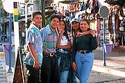 ECUADOR, HIGHLANDS, BANOS hot springs resort and teenagers