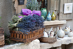 A box of local lavender entices outside a gift shop in Les-Baux-de-Provence.  This small hill town south of  Avignon and St. Remy has dominated its small mountain top since the 10th century.  Its narrow streets and tiny buildings now host numerous shops, eateries,and museums and welcome upwards of two million visitors annually.
