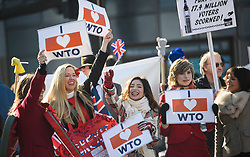 © Licensed to London News Pictures. 14/02/2019. London, UK. A group of Pro Brexit campaigners hold up signs outside the Houses of Parliament in Westminster, on the day that MPs are due to take part in further debates and votes on Brexit. A series of amendments are being tabled to try to change the direction of Brexit, but a vote on a deal will not be held today as was originally planned. Photo credit: Ben Cawthra/LNP