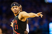 OKLAHOMA CITY, OK - APRIL 21: Seth Curry #31 of the Portland Trail Blazers points to the inbound during a game against the Oklahoma City Thunder during Round One Game Three of the 2019 NBA Playoffs on April 21, 2019 at Chesapeake Energy Arena in Oklahoma City, Oklahoma  NOTE TO USER: User expressly acknowledges and agrees that, by downloading and or using this photograph, User is consenting to the terms and conditions of the Getty Images License Agreement.  The Trail Blazers defeated the Thunder 111-98.  (Photo by Wesley Hitt/Getty Images) *** Local Caption *** Seth Curry