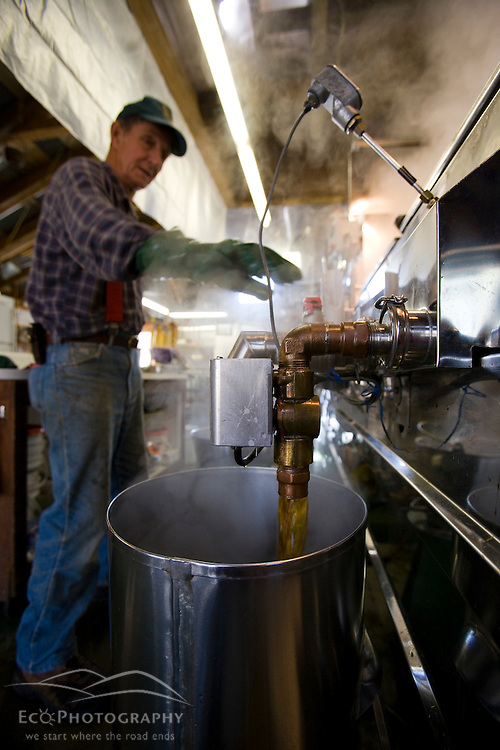 Paul Messer, Sr. makes syrup in his sugar house at the Sunday Mountain Maple Farm in Orford, New Hampshire.