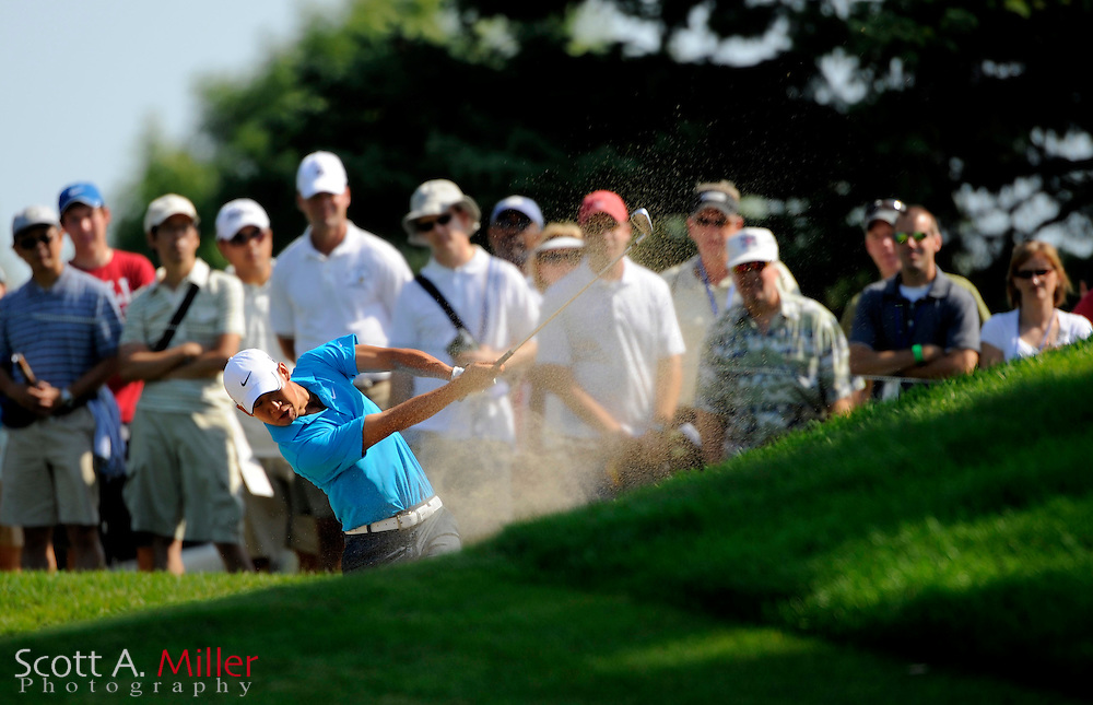 Aug 14, 2009; Chaska, MN, USA; Anthony Kim (USA) hits out of a fairway bunker on the second hole during the second round of the 2009 PGA Championship at Hazeltine National Golf Club.  ©2009 Scott A. Miller