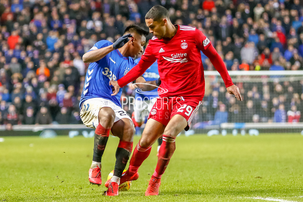 Max Lowe of Aberdeen FC takes Alfredo Morelos feet  during the William Hill Scottish Cup quarter final replay match between Rangers and Aberdeen at Ibrox, Glasgow, Scotland on 12 March 2019.