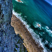 Leaning out over the edge at Cabo da Roca, the westernmost point on continental Europe - the sheer cliff helps define the brilliant colors of the Atlantic on a summer day. Shot with an Ultra-wide angle - helps get a sense of the curvature of the Earth on the horizon.