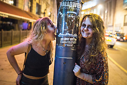 © Licensed to London News Pictures . 31/10/2015 . Manchester , UK . Halloween revellers , wearing make up and costumes , out and about in Manchester City Centre . Photo credit : Joel Goodman/LNP