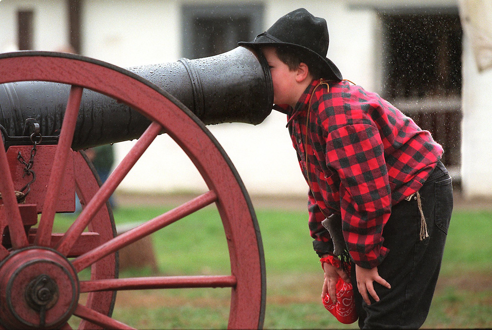 In costume Joey Sangiacomo 9, (cq) echos his voice into the cannon at Sutter's Fort. He was their with others in his 4th grade class for the opening of Sutter's Fort Sesquicentennial Gold Rush Exhibit. The event took place rain or shine. Fortunately Joey was also able to keep his nose dry for a short while.