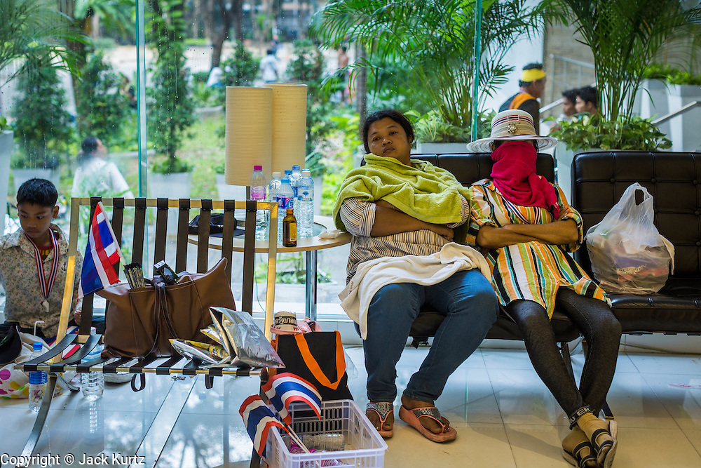 26 NOVEMBER 2013 - BANGKOK, THAILAND:  Thai anti-government protestors sleep in the lobby of the Ministry of FInance. Protestors opposed to the government of Thai Prime Minister Yingluck Shinawatra spread out through Bangkok this week. Protestors have taken over the Ministry of Finance, Ministry of Sports and Tourism, Ministry of the Interior and other smaller ministries. The protestors are demanding the Prime Minister resign, the Prime Minister said she will not step down. This is the worst political turmoil in Thailand since 2010 when 90 civilians were killed in an army crackdown against Red Shirt protestors. The Pheu Thai party, supported by the Red Shirts, won the 2011 election and now govern. The protestors demanding the Prime Minister step down are related to the Yellow Shirt protestors that closed airports in Thailand in 2008.    PHOTO BY JACK KURTZ