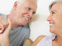 Couple holding hands and looking in eyes close-up