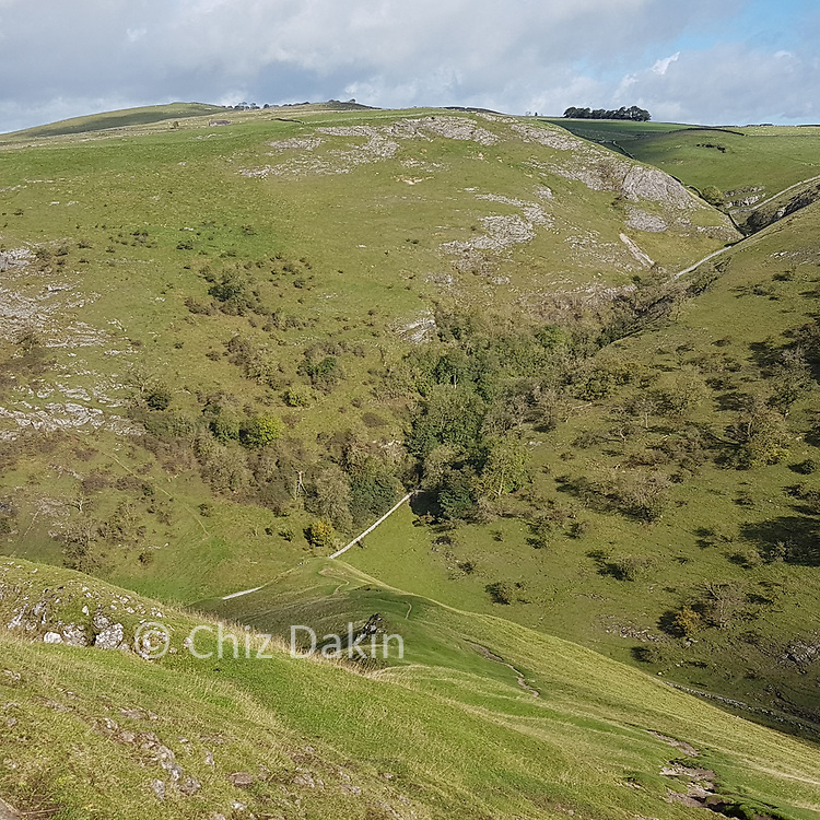 Looking down the steep grassy ramp leading off Thorpe Cloud