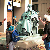 "November 19, 2009 - Lexington, Kentucky, USA - University of Kentucky students use their phones to take photos of a statue of UK's first president JAMES PATTERSON which had a cigarette taped to his mouth by students as they had a ""smoke-out"" to protest the University's tobacco ban on campus which began today. About a hundred student smokers and non-smokers gathered to protest the campus-wide tobacco ban UK implemented Thursday by continuously using tobacco products in front of Patterson Office Tower and on the Student Center patio. The ban prohibits the use of cigarettes, pipes, cigars and chewing tobacco, and extends to all properties owned by the university in Fayette County. (Credit image: © David Stephenson/ZUMA Press)"