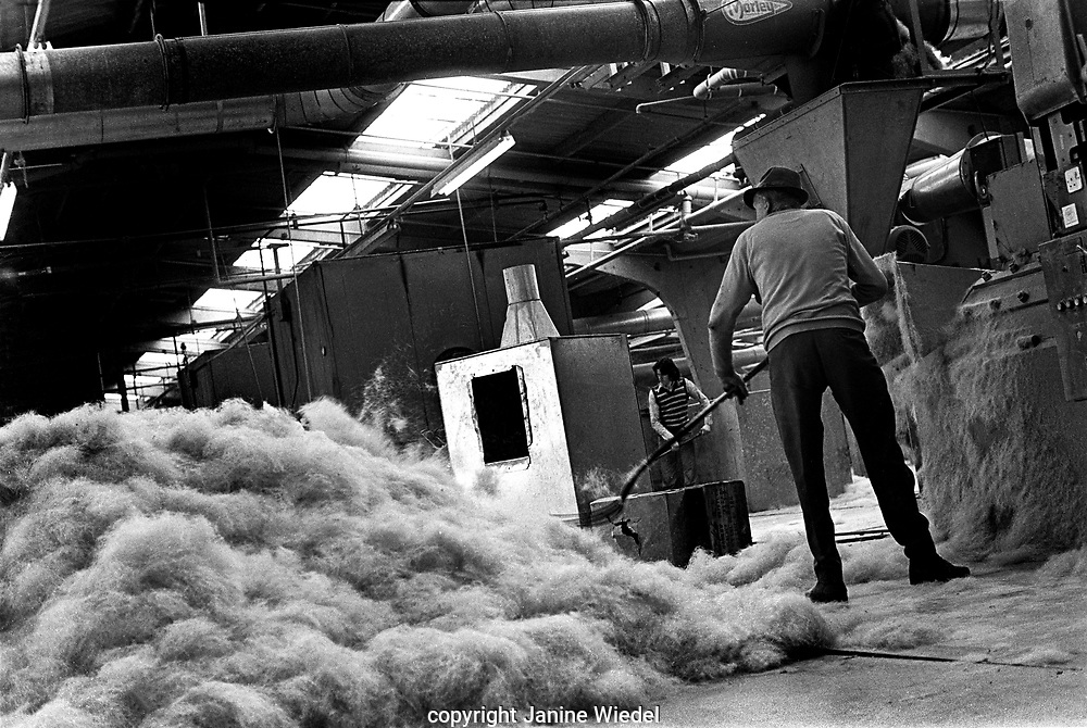 1970s at Harris Brush Works factory in Bromsgrove, Worcestershire is largest manufacturer of paint brushes as well as all  other brush products. Founded in 1928. In 1961 they were awarded the Royal Warrant by Her Majesty as the preferred manufacturer of paint brushes and decorating tools to the Royal Sandringham Estate.