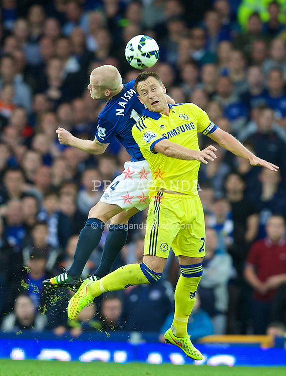 LIVERPOOL, ENGLAND - Saturday, August 30, 2014: Everton's Steven Naismith in action against Chelsea's captain John Terry during the Premier League match at Goodison Park. (Pic by David Rawcliffe/Propaganda)