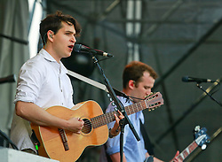 27 April 2014. New Orleans, Louisiana.<br /> Ezra Koenig (l) and Christopher Baio of Vampire Weekend at the New Orleans Jazz and Heritage Festival. <br /> Photo; Charlie Varley/varleypix.com