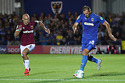 AFC Wimbledon striker James Hanson (18) dribbling during the EFL Carabao Cup 2nd round match between AFC Wimbledon and West Ham United at the Cherry Red Records Stadium, Kingston, England on 28 August 2018.