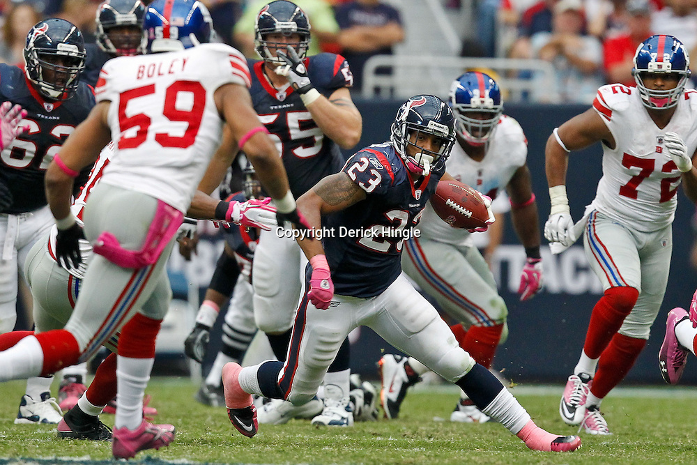 October 10, 2010; Houston, TX USA; Houston Texans running back Arian Foster (23) runs as New York Giants linebacker Michael Boley (59) pursues the play during the second half at Reliant Stadium. The Giants defeated the Texans 34-10. Mandatory Credit: Derick E. Hingle