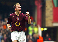 Photo: Chris Ratcliffe.<br />Arsenal v West Bromwich Albion. The Barclays Premiership. 15/04/2006.<br />Dennis Bergkamp of Arsenal celebrates his goal by pointing to his family on 'Dennis Bergkamp Day' at Highbury.