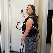 ARLINGTON, VA -JUNE3:  Tiffany Jolliff arrives home with her assistance dog, Railey, in Arlington, VA, June 3, 2016. The Washington Lawyers' Committee for Civil Rights and Urban Affairs filed a lawsuit Thursday in federal district court in the Eastern District of Virginia on behalf of Tiffany Jolliff against Uber, alleging violations of the Americans With Disabilities Act and the Virginians with Disabilities Act, alleging Uber unlawfully refused to accommodate Jolliff, who is blind, and her service dog, Railey. The complaint alleges that Jolliff, who works as a policy specialist for the federal government on employment for workers with disabilities, has been repeatedly discriminated against and denied Uber's services when Uber's drivers have seen that she is accompanied by her service dog Railey. Specifically, instead of accommodating her service dog Railey, as both the ADA and VDA require, Uber drivers have repeatedly driven off upon seeing that Ms. Jolliff had a service dog. (Photo by Evelyn Hockstein/For The Washington Post)