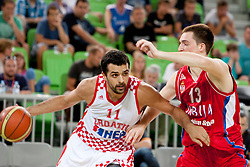 Krunoslav Simon of Croatia and Danilo Andusic of Serbia during friendly basketball match between National teams of Croatia and Serbia of Adecco Ex-Yu Cup 2012 as part of exhibition games 2012, on August 3rd, 2012, in Arena Stozice, Ljubljana, Slovenia. (Photo by Urban Urbanc / Sportida)