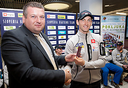Tomaz Lovse of SZS and Jakov Fak with new Slovenian passport at press conference of Slovenia Biathlon team before new season 2010 - 2011, on November 24, 2010, in Emporium, BTC, Ljubljana, Slovenia.  (Photo by Vid Ponikvar / Sportida)