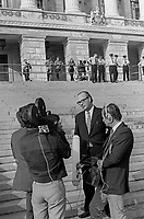 N Ireland Assembly - first meeting of the newly-elected members - 31st July 1973 - SDLP leader Gerry Fitt is interviewed by a television crew on the steps of Parliament Buildings, Stormont, Belfast, N Ireland, 197307310523b<br /> <br /> Copyright Image from Victor Patterson,<br /> 54 Dorchester Park, <br /> Belfast, UK, BT9 6RJ<br /> <br /> t1: +44 28 9066 1296 (from Rep of Ireland 048 9066 1296)<br /> t2: +44 28 9002 2446 (from Rep of Ireland 048 9002 2446)<br /> <br /> m: +44 7802 353836<br /> <br /> e: victorpatterson@me.com<br /> www.victorpatterson.com<br /> <br /> Please see my Terms and Conditions of Use at www.victorpatterson.com. It is IMPORTANT that you familiarise yourself with them.<br /> <br /> Images used on the Internet must be visibly watermarked i.e. © Victor Patterson<br /> within the body of the image and copyright metadata must not be deleted. Images <br /> used on the Internet have a size restriction of 4kbs and will be chargeable at current<br />  NUJ rates unless agreed otherwise.<br /> <br /> This image is only available for the use of the download recipient i.e. television station, newspaper, magazine, book publisher, etc, and must not be passed on to any third <br /> party. It is also downloaded on condition that each and every usage is notified within 7 days to victorpatterson@me.com<br /> <br /> The right of Victor Patterson to be identified as the author is asserted in accordance with The Copyright Designs And Patents Act (1988). All moral rights are asserted.