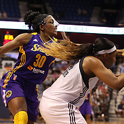 Nneka Ogwumike, (left), Los Angeles Sparks, challenges Kelsey Bone, Connecticut Sun, for a rebound during the Connecticut Sun Vs Los Angeles Sparks WNBA regular season game at Mohegan Sun Arena, Uncasville, Connecticut, USA. 3rd July 2014. Photo Tim Clayton