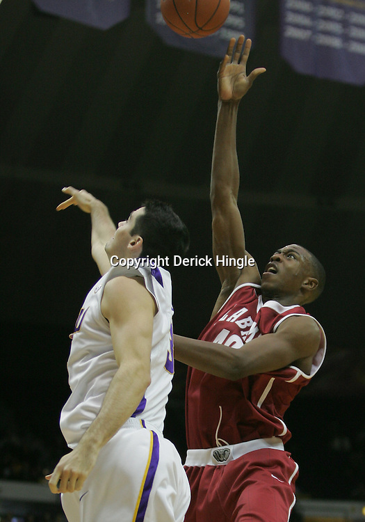 Jan 09, 2010; Baton Rouge, LA, USA; Alabama Crimson Tide forward Justin Knox (40) shoots over LSU Tigers forward Garrett Green (3) during the second half at the Pete Maravich Assembly Center. Alabama defeated LSU 66-49.  Mandatory Credit: Derick E. Hingle-US PRESSWIRE